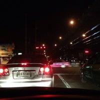 Photo taken at Prachanukun Intersection by ShowpowMay J. on 2/18/2014