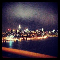 Photo taken at Williamsburg Bridge Pedestrian & Bike Path by Ajax on 3/26/2013