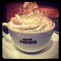 Photo taken at Caffé Nero by Defne A. on 12/15/2012