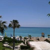 Photo taken at Ακτή του Ήλιου by Sofy P. on 5/24/2013