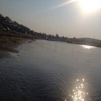 Photo taken at Bitez Han Beach Hotel by Deniz on 7/31/2015