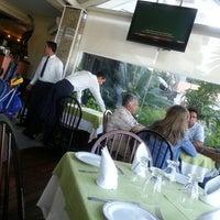 Photo taken at Dolphin Ristorante & Pizzeria by Fernando E. on 3/22/2013