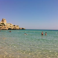 Photo taken at Spiaggia di Torre dell'Orso by Ezio on 6/19/2013
