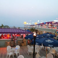 Photo taken at Martell's Tiki Bar by Ashley L. on 8/12/2013