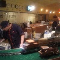 Photo taken at Sushi Train by David H. on 9/16/2012