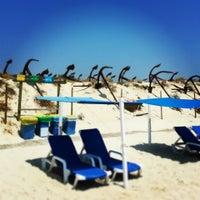 Photo taken at Praia do Barril by Maki on 7/20/2013