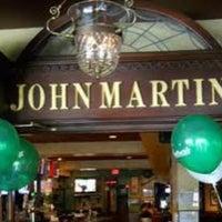 Photo taken at John Martin's Irish Pub & Restaurant by Carlos R. on 3/3/2013