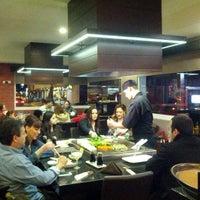Photo taken at Furasshu Japanese Cuisine by Gina M. on 2/3/2013