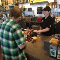 Photo taken at Einstein Bros Bagels by MED L. on 3/29/2013