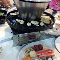 Photo taken at bao ding yan bbq steamboat by Jaysheini K. on 2/19/2013