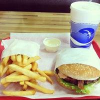 Photo taken at Apollo Burgers by Tiff on 7/10/2013