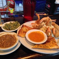 Photo taken at Gumbeaux's Cajun Cafe by Armon A. on 10/19/2013