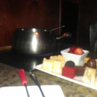 Photo taken at The Melting Pot by Luciana F. on 1/2/2013