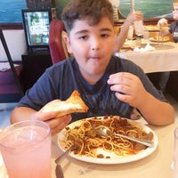 Photo taken at Capriano's Italian Cuisine by Wonder W. on 7/2/2017