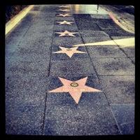 Photo taken at Hollywood Walk of Fame by Carlee C. on 6/28/2013