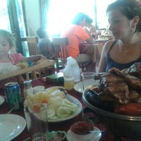 Photo taken at Restaurant 4 Puntos by Paly on 1/12/2013