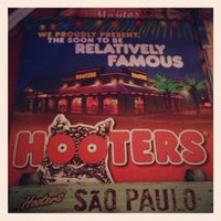Photo taken at Hooters by Nathália S. on 2/9/2013