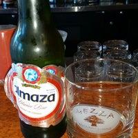 Photo taken at Mezza Restaurant by Joe D. on 9/3/2014