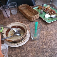 Photo taken at Sugar Bun Cafe by Qyeroll I. on 12/29/2013