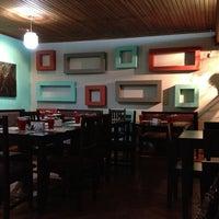 Photo taken at Mantras Café by Daniela R. on 5/4/2013