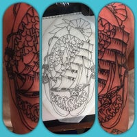 Photo taken at Let It Bleed Tattoo by Dannyboy on 9/8/2015