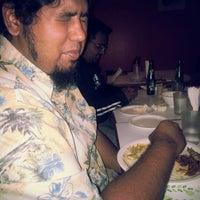 Photo taken at Toms Hotel by Aishwarya V. on 12/3/2012