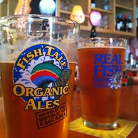 Photo taken at Fish Tale Brew Pub by Elena on 5/19/2013