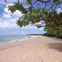 Photo taken at Nusa Dua Beach by Margarita A. on 1/21/2013