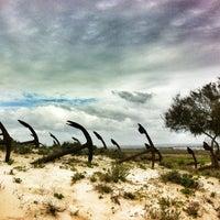 Photo taken at Praia do Barril by Gary J. on 3/30/2013