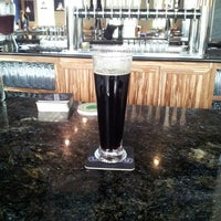 Photo taken at Latitude 42 Brewing Company by Dennis F. on 9/9/2013