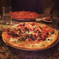 Photo taken at Barbarella Restaurant by John B. on 6/22/2013