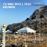 Photo taken at Kolymbia Beach by Andrea M. on 8/12/2013
