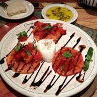 Photo taken at Carrabba's Italian Grill by Myron B. on 5/11/2013
