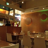Photo taken at Pinto Thai Bistro & Sushi Bar by Nikki C. on 1/30/2012