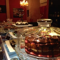 Photo taken at Le Rouge Confiserie & Caffé by Cyntia W. on 11/1/2014