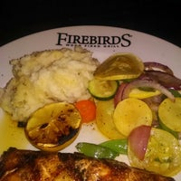 Photo taken at Firebirds Wood Fired Grill by Newyork on 6/21/2014