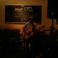 Photo taken at Midtown Wine Bar by Christian A. on 8/4/2013
