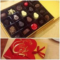Photo taken at Godiva Chocolatier by H.C. @. on 2/8/2016
