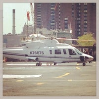 Photo taken at East 34th Street Heliport (TSS) by Donald Sturge Anthony M. on 7/21/2013
