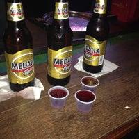 Photo taken at Olajas Bar & Grill by Dashira C. on 5/19/2014