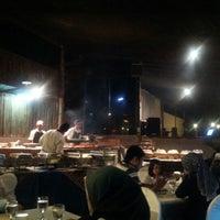Photo taken at The Gayam Seafood Barbeque & Bar by Awatif H. on 2/9/2013