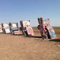 Photo taken at Cadillac Ranch by Ramona C. on 8/21/2013