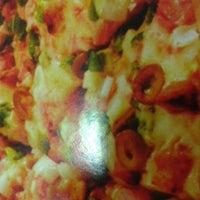 Photo taken at Super Pizza Pan by Caroline B. on 3/27/2013