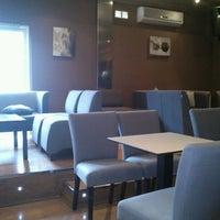 Photo taken at Iguana Cafe by Ζέτα Ν. on 4/12/2013
