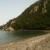 Photo taken at Olympos Plajı by Gul on 6/8/2013