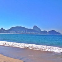 Photo taken at Copacabana Beach by Camila S. on 6/29/2013