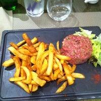 Photo taken at Le Cafe De La Paix by Laurent R. on 11/23/2012