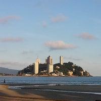 Photo taken at Praia do Gonzaguinha by Emilio P. on 7/29/2013