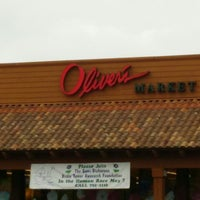Photo taken at Oliver's Market by Joshua S. on 4/10/2016