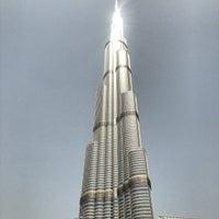 Photo taken at Burj Khalifa by Derek C. on 6/4/2013